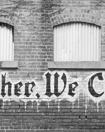 Bild: Steinwand mit Graffiti: Together we create!